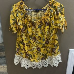Yellow floral top. Can be worn off the shoulders.